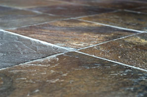 Aardvark Carpet Cleaning, Norwich | Your carpet and floor cleaning, and upholstery and curtain cleaning FAQs | Image: A dark stone tiled floor